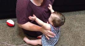Picking up baby with one arm