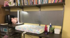 Adjustable baby changing table and book shelf